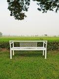 White bench in the garden Stock Image