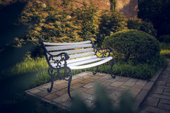 White Bench in the garden 5 royalty free stock images