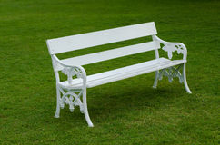 White Bench on green lawn Stock Image