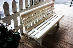 A white bench with horizontal plastic lozenges royalty free stock photo