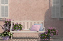 White bench near the house. White bench and flowers near the house royalty free stock photos
