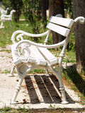 White bench in the park (1). White bench for restin in a park Stock Photography