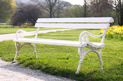 White bench in the park Royalty Free Stock Image