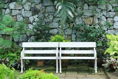 White bench. In the park royalty free stock images