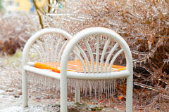 White bench in a park covered with ice Royalty Free Stock Images