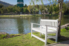 White bench in the park Royalty Free Stock Photo
