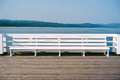 White bench on the pier. Sunny afternoon in Sopot, Pomeranian Royalty Free Stock Image