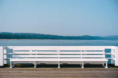 White bench on the pier. Sunny afternoon in Sopot, Pomeranian Stock Photography