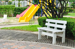 White bench in public garden. White bench in public garden Royalty Free Stock Photography