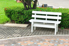 White bench in public garden. White bench in public garden Stock Photos