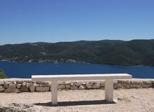 White bench and sea view stock photo