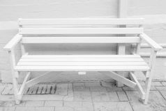 White bench seat. Public bench seat - white painted wood stock photo
