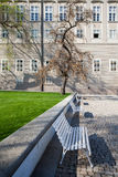 White bench in spring Garden Of Paradise. Near the Prague Castle royalty free stock image