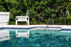 White Bench By Swimming Pool Royalty Free Stock Photo