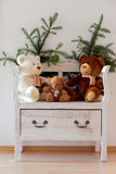 White bench with teddy bears and christmas sprig Stock Images