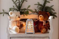 White bench with teddy bears and christmas sprig Stock Photography
