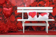 White bench and two pillows Stock Photography