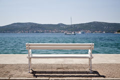 White bench under the sun Royalty Free Stock Image