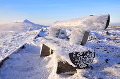 White bench. In winter mountains royalty free stock image