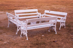 White Benches in Park. White Benches on Ground in Park Stock Photos