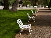 White benches of Prague. In the park of the city of Prague. Rows of white benches royalty free stock photography