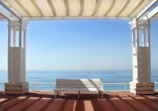 Promenade des Anglais in Nice, France. White benches on the Promenade des Anglais in Nice, France stock images