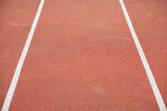 White bent lines marking red stadium with soft covering Royalty Free Stock Images