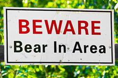 A white beware bear in area sign.  stock photography