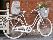 White bicycle-bags on brick wall background Stock Photos