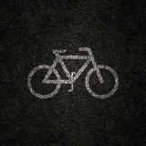White Bicycle Marking on a Asphalt Road BackGround royalty free stock photography