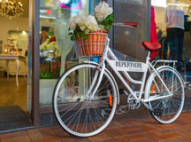 White bicycle-monument `Repertoire` at the shopping mall. Downtown of Wellington city, New Zealand. WELLINGTON CITY, NEW ZEALAND - 01 MARCH 2015: White bicycle Stock Photography