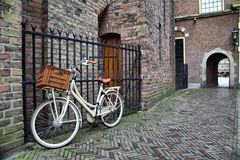 White bicycle near the lattice in Binnenhof. Hague, Netherlands Royalty Free Stock Photo
