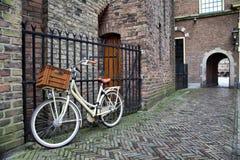 White bicycle near the lattice in Binnenhof Royalty Free Stock Photo