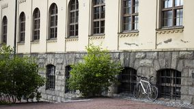 White Bicycle Parked Beside Gray Building Stock Photos