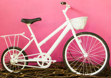White bicycle on pink wall Royalty Free Stock Photo