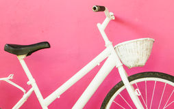 White bicycle on pink wall Stock Image
