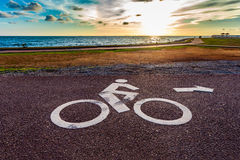 White bicycle road sign on asphalt lane Royalty Free Stock Photography