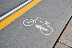 White bicycle sign painted on a street Stock Images
