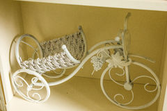White bicycle. White bicycle standing on a shelf Stock Image