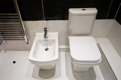White Bidet and Toilet Royalty Free Stock Photos