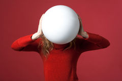 White big ball. Young woman with a white ball as a blank display Stock Photo