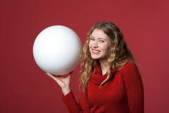 White big ball. Young woman with a white ball as a blank display Stock Image