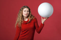 White big ball. Young woman with a white ball as a blank display Royalty Free Stock Image