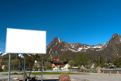 White big bilboard on norwegian road in sunny day. Big white bilboard on the norwegian road in sunny day royalty free stock image