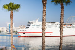 White big board leaving Malaga's port. Spain. Royalty Free Stock Photography