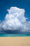 White big cloud over ocean and white sand beach Royalty Free Stock Photo