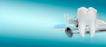 White big healthy tooth and different tools for dental care, on gradient dental background. banner size. White big healthy tooth and different tools for dental royalty free stock image