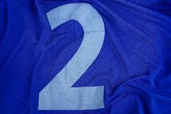 Big number two on blue cloth sports uniforms. White big number two on blue cloth sports uniform royalty free stock photo