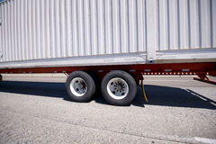 White Big rig Semi trailer with dual axle wheels on road Royalty Free Stock Photos