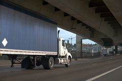 Big rig semi truck with day cab and covered tarp semi trailer go royalty free stock images